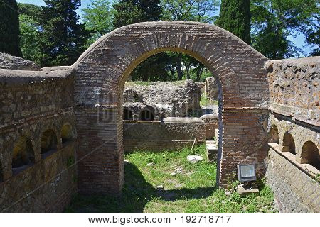 The ruins of Via Delle Tombe in Ostia Antica near Rome Italy. It was Rome's ancient port before the river silted it fell into decay with the end of the Roman empire and was abandoned in the 9th century