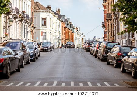 BRUSSELS, BELGIUM - June 01, 2017: Street view with beautiful residential buildings near the Cinquantenaire Park in Brussels