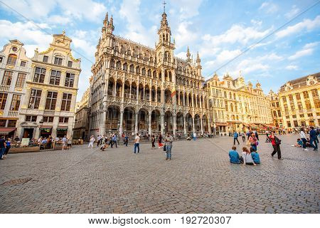 BRUSSELS, BELGIUM - June 01, 2017: Crowded with tourists Grand place square with museum building during the sunset in the center of the old town of Brussels