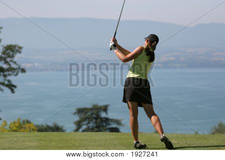 Lady golf swing over the Leman Lake poster