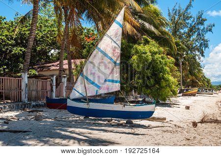 Ramena Madagascar - December 20 2015: Traditional Malagasy wooden fishing sail boats on the sea coast Madagascar East African Islands Africa.