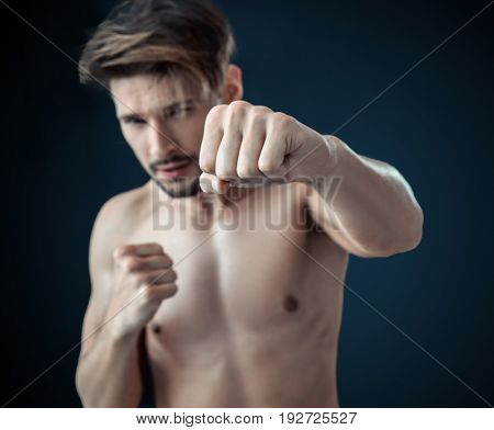Man throwing a fierce and powerful punch