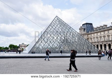 PARIS - April 16: The Louvre Pyramid on April 16, 2017 in Paris, France. It serves as the main entrance to the Louvre Museum (Musee du Louvre). Completed in 1989 it has become a landmark of Paris.