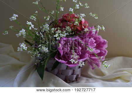 delicate flowers in basket , still life with flowers