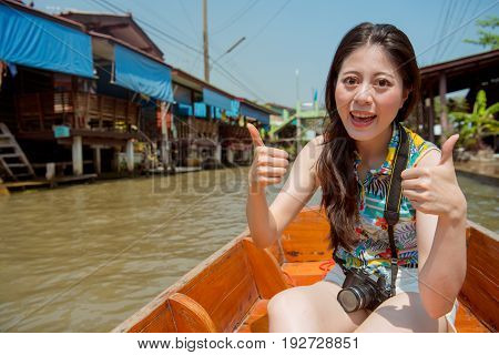 Tourist Girl At Thailand Thumbs Up Hand Sign
