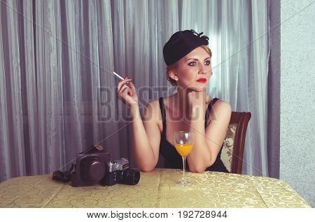 Vintage woman portrait closeup with the cigarette