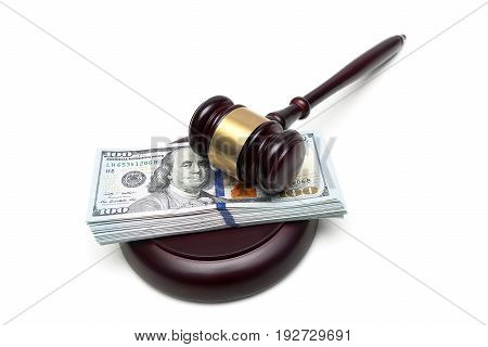 Money and a hammer of the judge on a white background. Horizontal photo.