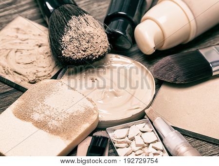 Makeup products for flawless complexion: foundation, concealer, powder. Shallow depth of field, toned image