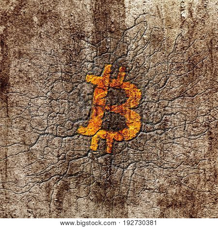 Bitcoin symbol on grunge textured cracked background