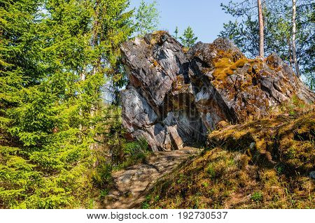 Mossy rocky ledge in Ruskeala Park in Republic of Karelia (Russia)