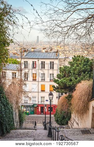 Paris France - April 19 2013: Morning view of cozy nook with pedestrians stairway in Montmartre.