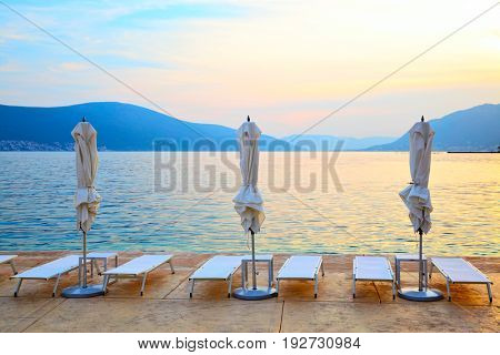 Picturesque view of beach in Bay of Kotor at sundown, Montenegro