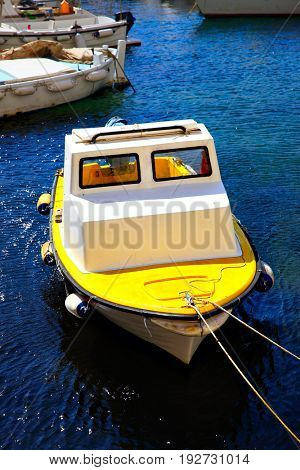 Small fishing boat in Old port of Dubrovnik, Croatia