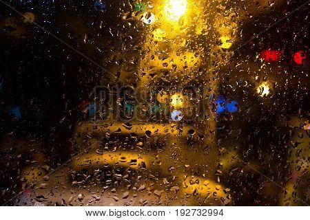 background,night light,rainy season,Reflection light,Water reflection,glass,Rainfall,Colorful light,Droplets on the glass floor