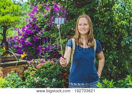 Young Beautiful Girl Doing Selfie Mobile Phone In The Park On Summer Day
