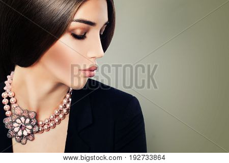 Young Woman Fashion Model with Makeup and Jewelry Necklace on Banner Background