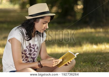 She Loves To Read The Book In Nature