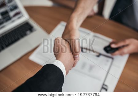 Man And Salesperson At Car Dealership