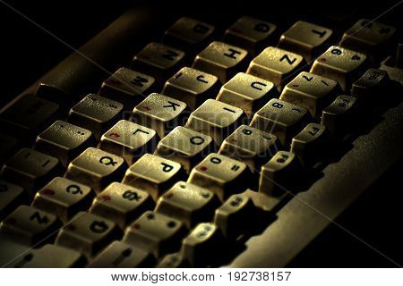 The old dirty keyboard of the computer in close-up