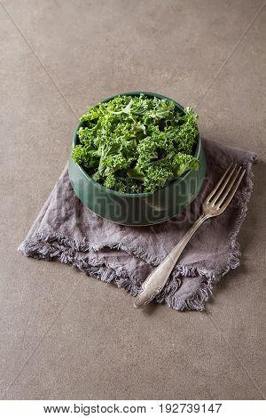 Fresh Green Italian Salad Kale. Dark Background.