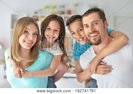 Portrait of happy family having fun indoors
