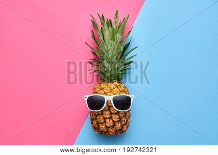 Fashion Hipster Pineapple Fruit. Bright Summer Color, Accessories. Tropical pineapple with Sunglasses. Creative Art concept. Minimal style. Summer party background