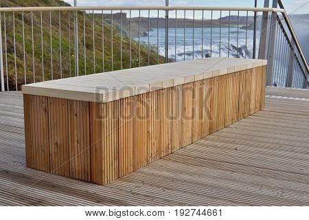 High quality brand new bench made of wooden boards as a symbol of sitting and relaxing
