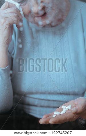 Older Lady Looking At Medicines