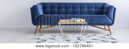 Sofa, Rug And Table With Book