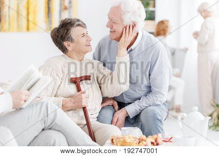 Loving older couple in a nursing home together
