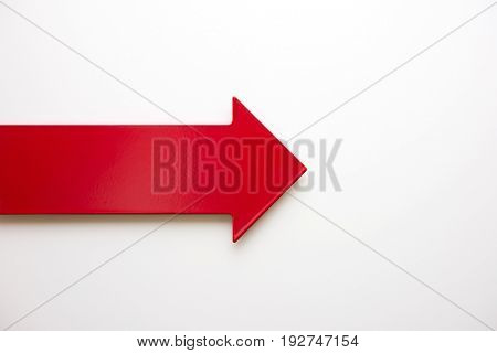 Big real red arrow for presentation or slideshow. pointing right for, progress or flow.Natural white background.