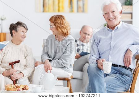Elderly people drinking coffee in the afternoon in nursing home