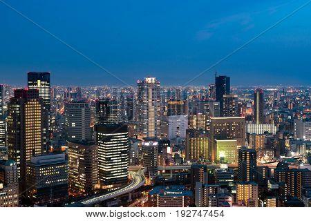 Osaka downtown city skyline at the landmark Umeda District in Osaka Japan.