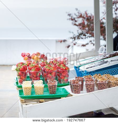 Selling fresh fruits and nuts on a street tray