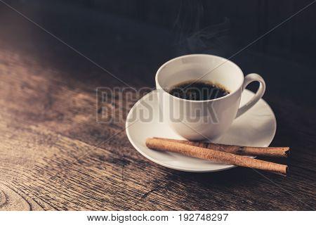 Hot Coffee Espresso Coffee cup. Cinnamon Coffee on wood table.