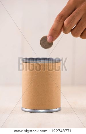 Putting money into donation box. Donate concept.