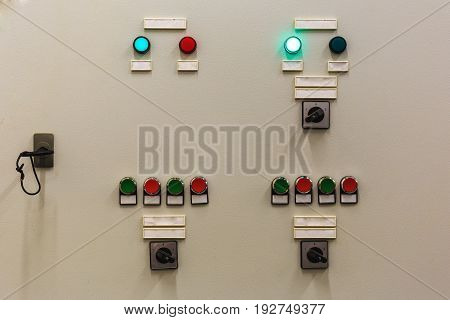 Control panel of the cooling system in server room of network data center with luminous buttons