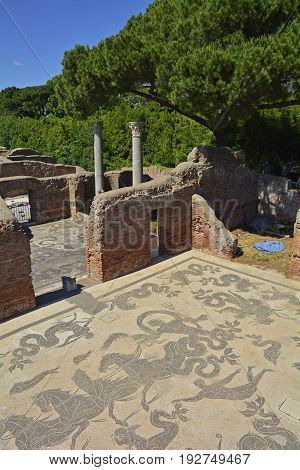 The ruins of the Baths of Neptune dating from 2AD in Ostia Antica near Rome Italy. It was Rome's ancient port before the river silted it fell into decay with the end of the Roman empire and was abandoned in the 9th century