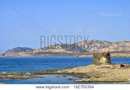 Amazing view of the famous La Pelosa Beach with the landmark 16th century Watchtower (Torre della Pelosa)