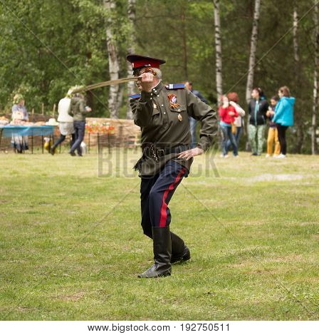 RUSSIAN SOSENSKY JULY 4 2017 White Sunday. Cossack dances with a sword during the Trinity feast