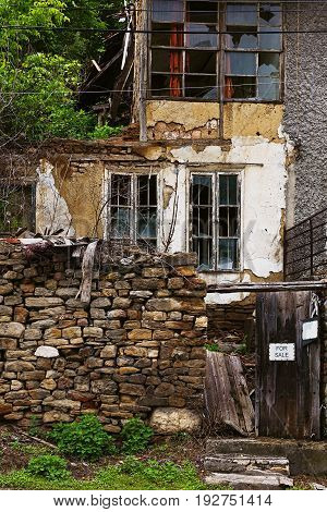 VELIKO TARNOVO, BULGARIA - MAY 28, 2017: Abandoned residental building on minor street