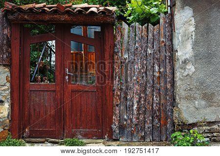 VELIKO TARNOVO, BULGARIA - MAY 28, 2017: Abandoned gate of residental building