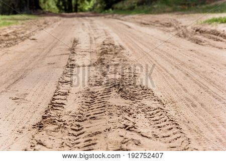 Tread marks on the dry rural sandy road