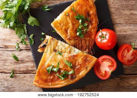 Homemade Sliced Burek Stuffed With Meat Close-up On A Table. Horizontal Top View