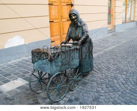 Sculpture Of Old Women In Szekesfehervar.