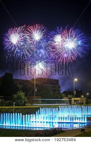 Brightly colorful fireworks above the city water fountains during the International fireworks festival in Zagreb Croatia.