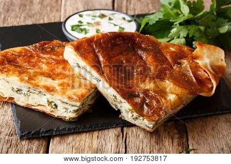 Homemade Sliced Burek Stuffed With Spinach And Cheese Close-up. Horizontal