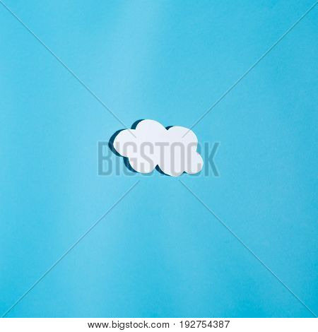 Paper cloud with hard shadow on a blue background