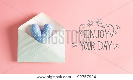 Enjoy Your Day message with a blue heart cushion in an envelope