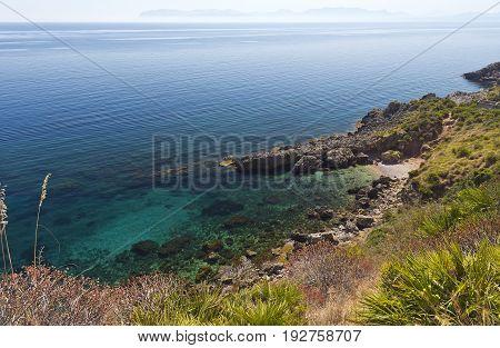 A small pebble beach Lo Zingaro Nature Reserve in Sicily Italy